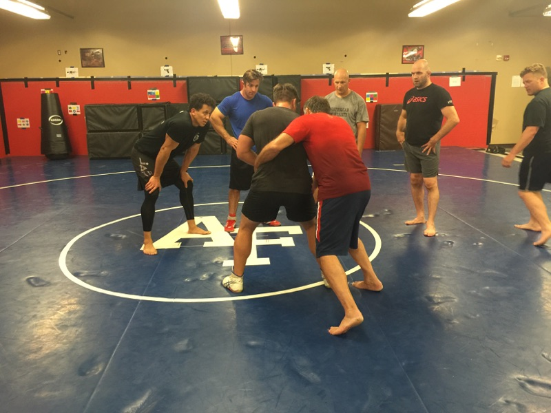 Matt Lindland and US Greco Roman team teaching hand to hand fighting to US Army