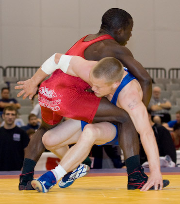 Spenser Mango attempts to lift Sam Hazewinkel