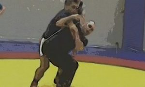 US coach Matt Lindland teaches Greco Roman arm throws at the Olympic Training Center