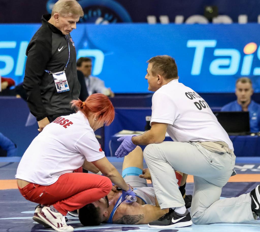 Geordan Speiller injured at the 2018 Worlds vs. Luis Avendano Rojas (VEN)